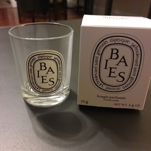 Empty Diptyque votive glass and box